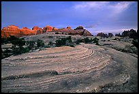 Sandstone swirls and Needles with last light, the Needles. Canyonlands National Park ( color)