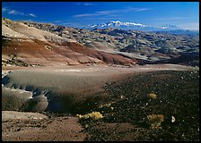 Bentonite hills and Henry Mountains. Capitol Reef National Park, Utah, USA. (color)