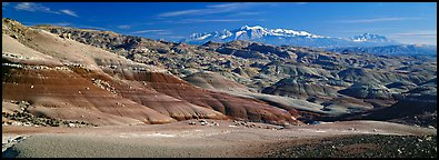 Mudstone landscape and snowy mountains, Cathedral Valley. Capitol Reef National Park (Panoramic color)