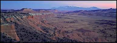 Desert view with cliffs and mountains at dusk. Capitol Reef National Park (Panoramic color)