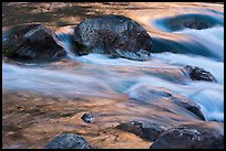 Boulders and rapids with glow from canyon walls reflected. Grand Canyon National Park ( color)