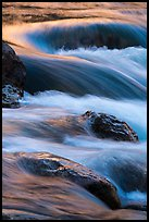 Boulders and rapids with warm light from canyon walls reflected. Grand Canyon National Park ( color)