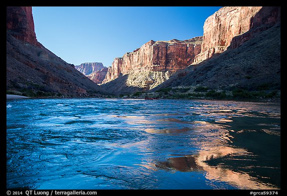 Cliffs reflected in Colorado River rapids, morning. Grand Canyon National Park (color)