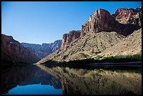 Buttes and glassy reflections in Colorado River. Grand Canyon National Park, Arizona, USA.