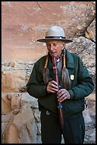 Native American Ranger plays flute to honor ancestors. Mesa Verde National Park ( color)