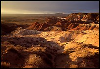 Badlands of  Chinle Formation seen from Whipple Point, stormy sunset. Petrified Forest National Park, Arizona, USA.
