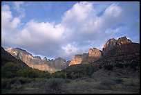 Wide view of Towers of the Virgin and clouds at sunrise. Zion National Park, Utah, USA.