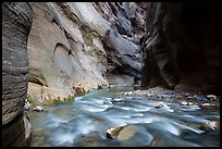 Virgin River flows over boulders under soaring walls of the Narrows. Zion National Park ( color)