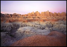 Cracked mudstone and eroded towers near Cedar Pass, dawn. Badlands National Park, South Dakota, USA. (color)