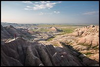 Park visitor looking, Panorama Point. Badlands National Park, South Dakota, USA. (color)
