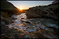 Outlet stream of Swiftcurrent Lake, sunrise. Glacier National Park, Montana, USA.
