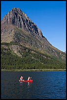 Red canoe on Swiftcurrent Lake. Glacier National Park, Montana, USA. (color)