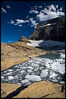 Icebergs in Upper Grinnel Lake, with glacier and Mt Gould in background. Glacier National Park, Montana, USA. (color)