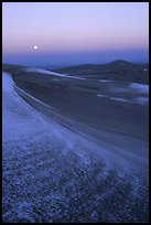 Dunes at dawn with snow and moon. Great Sand Dunes National Park and Preserve, Colorado, USA.