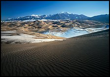 Rippled dunes and Sangre de Christo mountains in winter. Great Sand Dunes National Park, Colorado, USA. (color)
