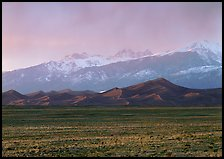 Flats, sand dunes, and snowy Sangre de Christo mountains. Great Sand Dunes National Park and Preserve, Colorado, USA.