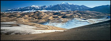 Landscape of sand dunes and mountains in winter. Great Sand Dunes National Park (Panoramic color)
