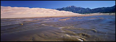 Wide shallow creek at the base of dune field. Great Sand Dunes National Park (Panoramic color)