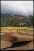 Rainbow over dune field. Great Sand Dunes National Park, Colorado, USA. (color)
