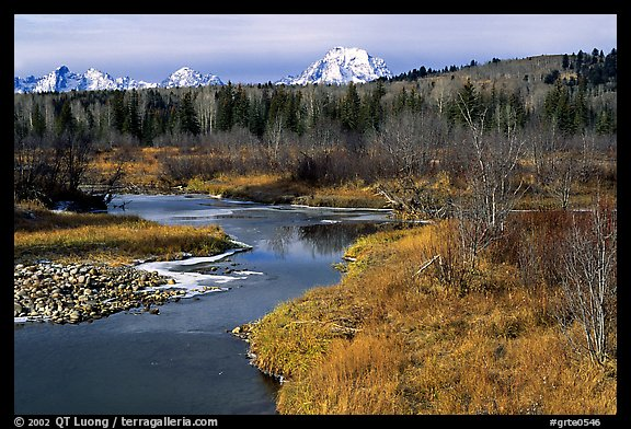 Stream, with Mt Moran emerging from ridige, late fall. Grand Teton National Park, Wyoming, USA.