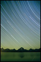 Star trails on Teton range above Jackson lake, dusk. Grand Teton National Park ( color)