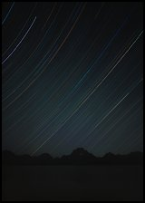 Star trails and Teton range. Grand Teton National Park ( color)