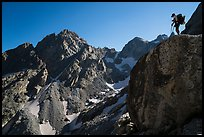 Mountaineer stands on rock looking at peaks, Garnet Canyon. Grand Teton National Park ( color)