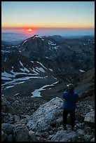 Mountaineer photographs sunset from Lower Saddle. Grand Teton National Park ( color)