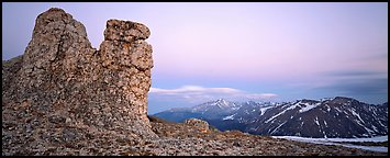 Rock towers on high pass and mountains at dusk. Rocky Mountain National Park (Panoramic color)
