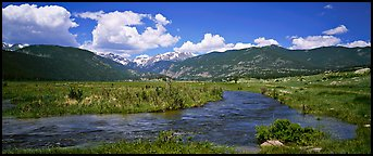 Mountain scenery with green meadows and stream. Rocky Mountain National Park (Panoramic color)