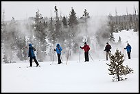 Skiers and thermal steam. Yellowstone National Park, Wyoming, USA. (color)