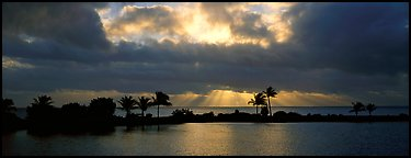 Sunrise with dark clouds over coastal lagoon. Biscayne National Park (Panoramic color)
