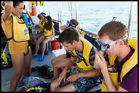 Snorklers getting ready on boat. Biscayne National Park, Florida, USA. (color)