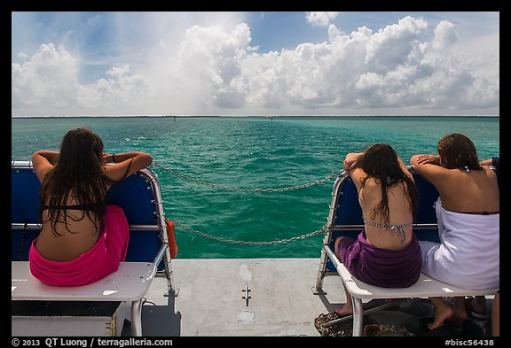 Women sunning themselves on snorkeling boat. Biscayne National Park, Florida, USA.