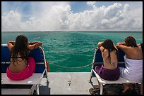 Women sunning themselves on snorkeling boat. Biscayne National Park, Florida, USA. (color)