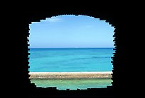 Turquoise waters framed by a cannon embrasure in Fort Jefferson. Dry Tortugas National Park, Florida, USA.