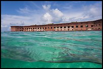 Split view of Fort Jefferson and water with fish. Dry Tortugas National Park, Florida, USA. (color)
