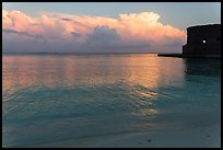 Tropical clouds, beach, and fort at sunrise. Dry Tortugas National Park, Florida, USA. (color)