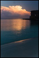 Beach, cloud and fort at sunrise. Dry Tortugas National Park, Florida, USA. (color)