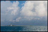Loggerhead key and lighthouse under tropical clouds. Dry Tortugas National Park, Florida, USA.