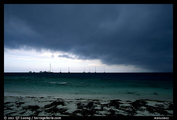 Approaching storm over Yachts at Tortugas anchorage. Dry Tortugas National Park, Florida, USA.