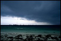 Approaching storm over Yachts at Tortugas anchorage. Dry Tortugas National Park, Florida, USA. (color)