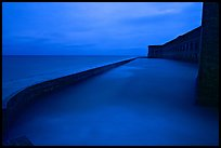 Seawall at dusk during  storm. Dry Tortugas National Park, Florida, USA.
