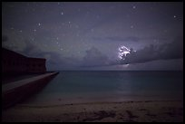 Fort Jefferson and beach at night with cloud electric storm. Dry Tortugas National Park, Florida, USA. (color)