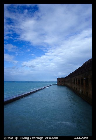 Sky, seawall and moat on windy day. Dry Tortugas National Park, Florida, USA.