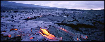 Volcanic landscape with molten lava low. Hawaii Volcanoes National Park (Panoramic color)