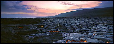 Landscape with red lava flow at sunset. Hawaii Volcanoes National Park (Panoramic color)