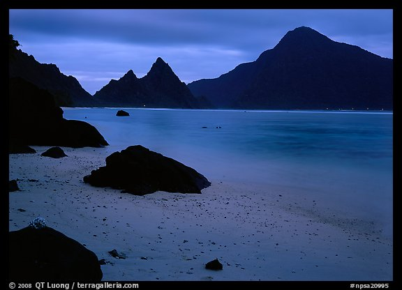 Beach and pointed peaks at dusk, Ofu Island. National Park of American Samoa