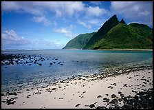 Tropical beach with sand and pebbles, and pointed peaks of Ofu Island. National Park of American Samoa ( color)
