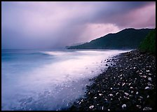Coastline with dark rocks, light water and storm sky at sunrise, Vatia bay, Tutuila Island. National Park of American Samoa (color)